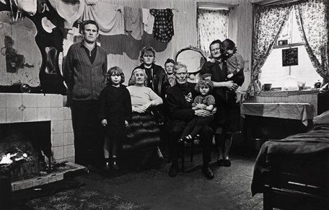 An Irish family living in a single basement room – tenants of a multi-let house. Liverpool Toxteth, November 1969 Credits : © Nick Hedges / National Media Museum, Bradford